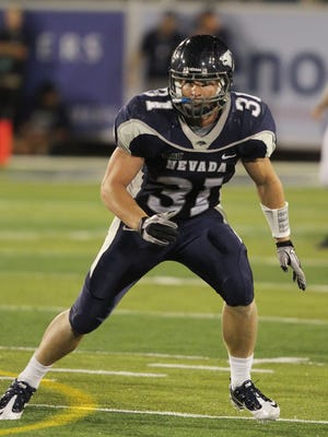 Kevin Grimes began his career at Nevada as a walk-on before earning a scholarship.
