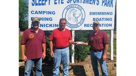 Pictured, from left:  Sportsmen's Club member Larry Helget, Parks Director Steve Lingen and club member Dave Hertling.