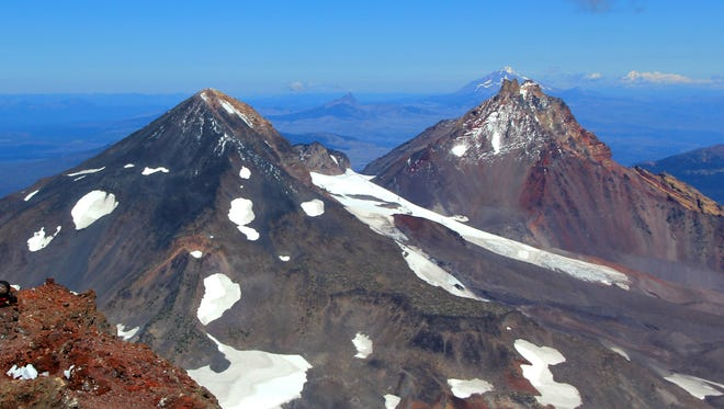 Middle Sister, left, and North Sister as seen from the view from the summit of South Sister.