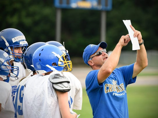 Cathedral coach Mark Chamernick gives the next play