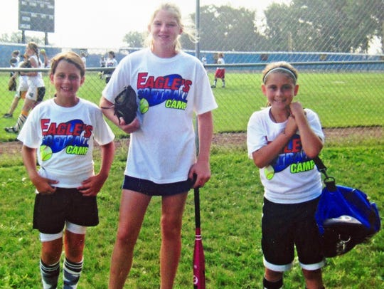 Mary Armstrong (middle) attended the Lakeland softball