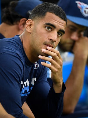 Titans quarterback Marcus Mariota sits on the bench during the second half of their game against the Texans at NRG Stadium  Sunday, Oct. 1, 2017 in Houston, Texas. Mariota injured his hamstring in the 57 to 14 loss.