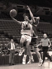 Kim Perrot (12) of the USL Lady Cajuns goes up for