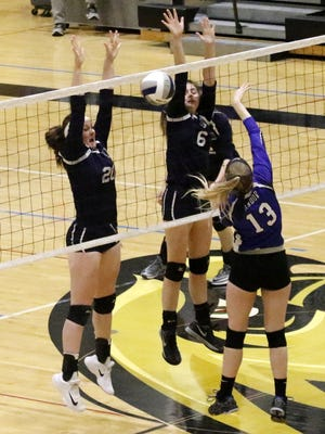 Alexis Carr, left, and Makenzie Drown of Bainbridge-Guilford go up for the block against Candor's Abbey Quick during the Section 4 Class D final Nov. 4 at Corning-Painted Post High School.