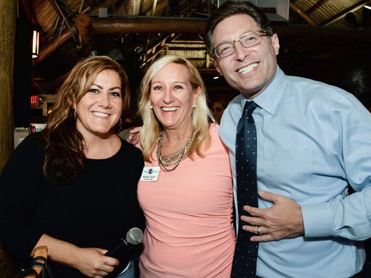 Lynette Marraffa of Traxx Entertainment, left, joins Family Meals Founder and President Martha Taylor with special guest WPTV NewsChannel 5's Jon Shainman at the Nov. 8 friendly bartenders competition at Cobbs Landing to raise funds for Family Meals.