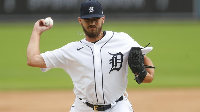 Gibraltar Carlson graduate John Schreiber pitches for the Detroit Tigers against Cincinnati Sunday.