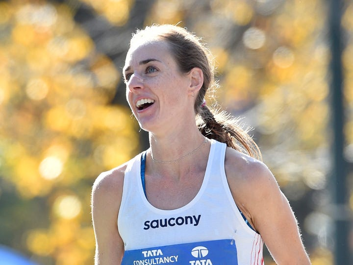 Molly Huddle reacts after crossing the finish line