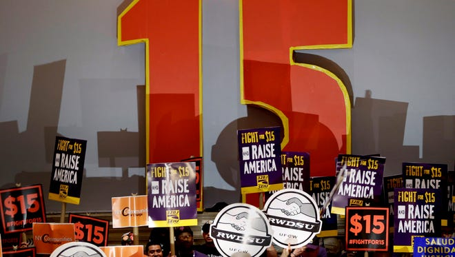 Demonstrators rally for a $15 minimum wage before a meeting of the wage board in New York, Monday, June 15, 2015.