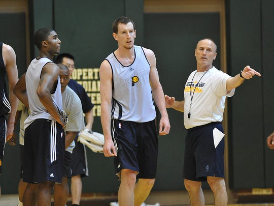 Purdue's E'Twaun Moore, left, and Butler's Matt Howard listen to Pacers assistant coach Dan Burke set up a play at the Indiana Pacers pre draft workout at Conseco Fieldhouse Tuesday June 7, 2011.  Joe Vitti / The Star