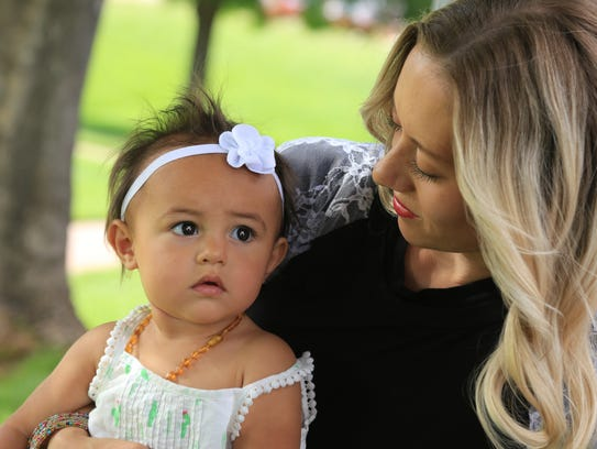 Chelsea Judd holds her daughter, Giselle, who was conceived