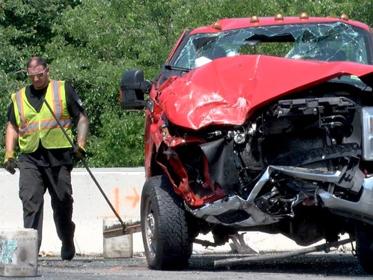 A pickup truck that collided with a sedan on Route