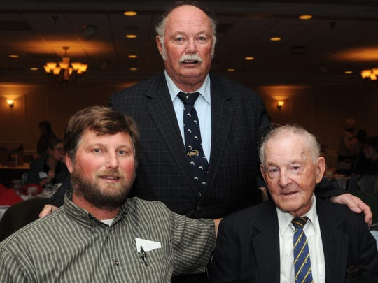 Three generations of the Daniels family, from left, Lee Daniels, his father,Capt. Stan Daniels and grandfather Capt. Art Daniels, pose during the Lower Eastern Shore Heritage Council's 6th annual meeting where Art Daniels was honored with the 2010 Legacy Award.