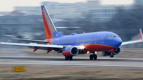 A Southwest Airlines jet lands Feb. 3, 2014, at Love