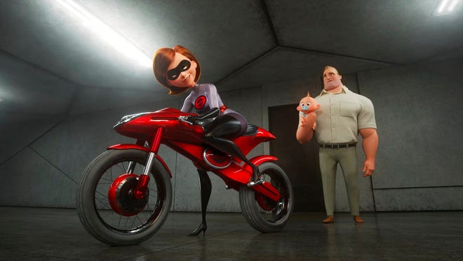 "Helen/Elastigirl, voiced by Holly Hunter, left, and Bob/Mr. Incredible, voiced by Craig T. Nelson, in ""Incredibles 2."" The movie is playing at Regal West Manchester Stadium 13, Frank Theatres Queensgate Stadium 13 and R/C Hanover Movies."