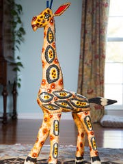 "Stylemaker Gray Middleton's favorite piece of artwork is ""George the Giraffe"", a hand crafted sculpture she purchased while on a mission trip in Guatemala."