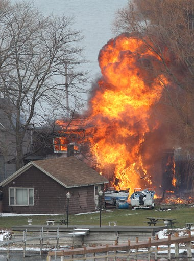 A house burns Monday December 24, 2012, in Webster.after William Spengler Jr. set fire and then shot and killed two responding firefighters while injuring two other firefighters.  The man was later found dead.