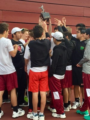 The Ithaca boys tennis team celebrates its STAC title on Tuesday.