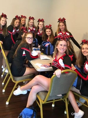 Jupiter Christian School varsity cheerleaders take part in hand writing positive messages to be placed in the Blessing Bags at Place of Hope. Their mission: to put a smile on a child's face.