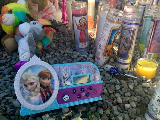 A memorial for a 10-year-old Albuquerque girl who police said was sexually assaulted, strangled then dismembered is shown at an Albuquerque apartment on Friday, Aug. 26, 2016 On the day a girl was going to celebrate her 10th birthday, she was found dead Wednesday in her family's apartment by Albuquerque police, her dismembered remains lying under a burning blanket. The girl's mother, 35-year-old Michelle Marten, her 31-year-old boyfriend, Fabian Gonzales, and his 31-year-old cousin, Jessica Kelley, are facing charges.