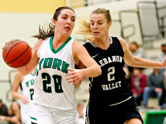 York College's Beth Wiseley, left, moves the ball down
