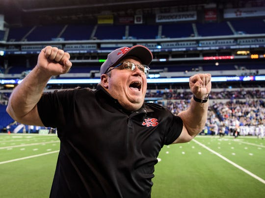 Southridge Head Coach Scott Buening jumps up and down as his team wins the IHSAA Class 2A State Championship title at Lucas Oil Stadium in Indianapolis, Ind., Saturday, Nov. 25, 2017. The Raiders defeated the Warriors, 15-14, to win their first state title in school history.