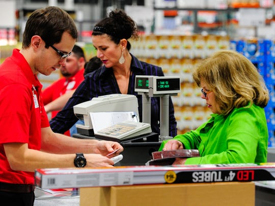 Shoppers buy items at Costco in Lafayette in March
