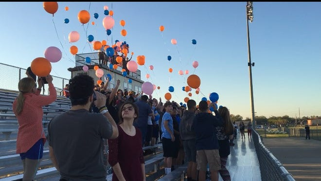 Medina families release balloons Tuesday in memory of twins Shawn and Keyshawn Collier at South Gibson County High School.