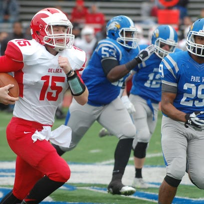 Delsea quarterback Quinn Collins looks for running room in the second half of Saturday's game. The senior rushed for 185 yards and three TDs,