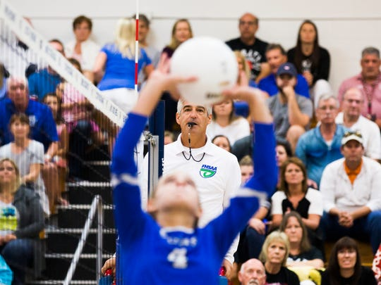 Senior Anna Marie Parisi sets the ball on Tuesday, November 7, 2017 during the 7A regional final game against Port Charlotte at Barron Collier High School.