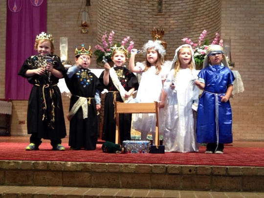 """Our Lady of Prompt Succor pre-K students shake jingles as they sing """"Jingle Bells"""" dressed as Mary, Joseph, an angel and the three wise men for their parents Thursday."""