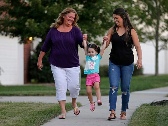 Shana Muse, left, walks with her daughter, Rachael