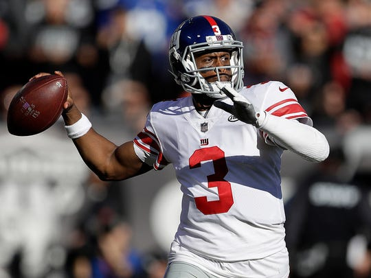 New York Giants quarterback Geno Smith (3) passes against the Oakland Raiders during the first half of an NFL football game in Oakland, Calif., Sunday, Dec. 3, 2017.