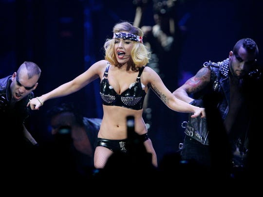 "Scores of Lady Gaga's ""Little Monsters"" came to her debut Milwaukee concert with elaborate outfits inspired by the pop star. She played a sold-out Bradley Center on Sept. 2, 2010."