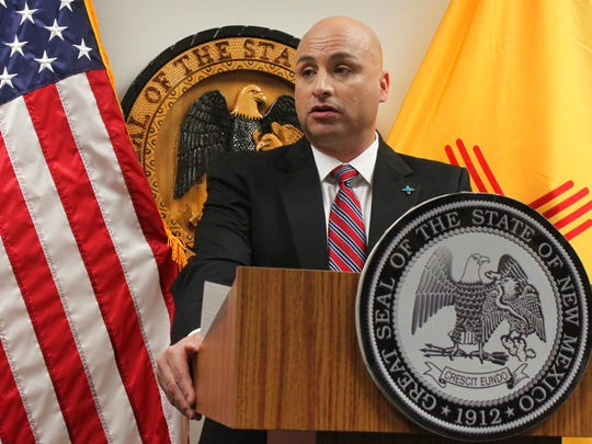 "In this Oct. 30, 2017 file photo, New Mexico Attorney General Hector Balderas discusses a settlement with one of the state's largest health insurance providers over unpaid premium taxes during a news conference in Albuquerque.  Democratic attorneys general are demanding the Trump administration end a ""zero tolerance"" policy that has resulted in children being separated from their parents at the U.S.-Mexico border. Led by Balderas, 21 top state prosecutors from California to Massachusetts sent a letter Tuesday, June 19, 2018,  to U.S. Attorney General Jeff Sessions and Homeland Security Secretary Kirstjen Nielsen."