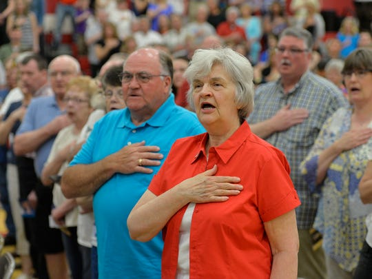 Hundreds say the Pledge of Allegiance Monday, May 30, as they gather for a Memorial Day ceremony at Upsala High School.