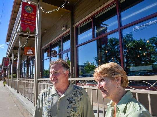 Colleen Hollinger and her husband, John Petters, owners of Collegeville Companies, talk outside some of the Mill Stream Shops and Lofts they own Thursday about some of the reasons they invested in downtown St. Joseph.
