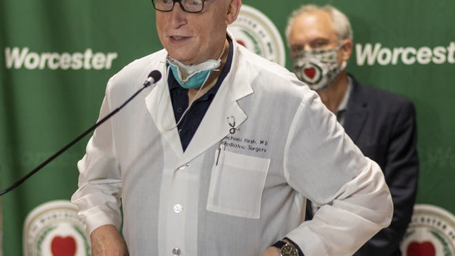 Dr. Michael Hirsh speaks during a City Hall press briefing in June.