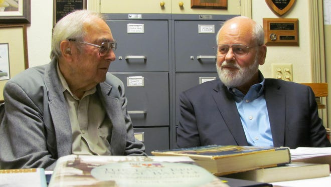 Larry Epping and Denny Miles talk about the Battle of Leyte Gulf at Epping's office on Monday, Oct. 24, 2011. Epping was aboard the Gambier Bay during that famous World War II battle, and Miles became interested in the history of the battle when he discovered it started the day he was born.