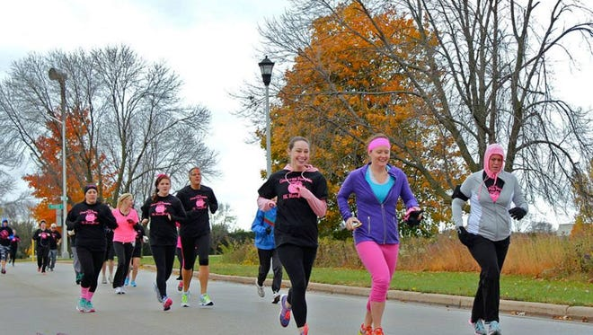 Runners sport their pink while participating in the 2014 Great Pink Pumpkin 5K Run/Walk benefiting breast cancer survivors.
