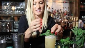 Jackie Zykan - the former beverages director at Doc Crow's who now works for Old Forester - mixes a Mint Julep Lemonade.