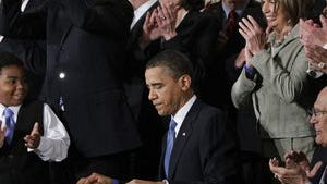 President Barack Obama is applauded on March 23, 2010, after signing the Affordable Care Act into law in the East Room of the White House in Washington.
