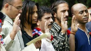 Emad Youseff, center, an immigrant from Egypt, and others takes the Oath of Allegiance to complete their US citizenship Sept. 17, 2003. Sixty immigrants from 30 countries participated in the first Naturalization ceremony to be held at The Hermitage, the historic home of president Andrew Jackson.