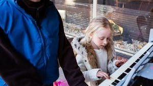 Children play a tune on the public piano placed in downtown Chambersburg this summer, The downtown piano project has been so popular since that the piano will remain available for locals to stop by and play, until the weather turns colder.