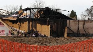 An apartment building under construction at 283 Grandview Ave. was damaged by a Jan. 15 fire. An arrest has been made in the case.