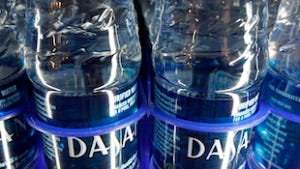 In this Dec. 9, 2009 file photo, bottled water sits on the shelf at The University of Vermont. The school is banning the sale of bottled water, with plans to convert campus water fountains to bottle filling stations.