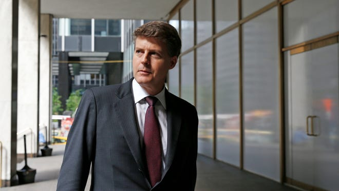 New York Yankees owner Hal Steinbrenner stops to talk to the media before attending a meeting of Major League Baseball's executive committee during baseball's owners meetings at MLB headquarters in midtown Manhattan, Wednesday, May 18, 2016, in New York.  Steinbrenner backed manager Joe Girardi and his coaching staff and has instead blamed players for the team's slow start. The Yankees are last in the American League East division at 16-22.