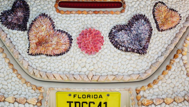 """The Shell Love Bug was unveiled on June 19, 2016 on National Seashell Day on Sanibel Island. The Lee County Visitor and Convention Bureau sponsored the event. Pam Rambo along with volunteers glued the shells to the car. Rambo claims the county promised to give her the car. Her company has sued Lee County in U.S. District Court. She also claims that by continuing to display the vehicle in public, the county has violated her copyright on the design. The News-Press tried to get access to the car to get photos of what it looks like in 2018 but was denied. In an email written by Lee County Spokeswoman Betsy Clayton: """"Per the County Attorney's Office, we are not able to accommodate your request. The car is covered and is not available for public or media inspection at this time since the design of the shells attached to the car is involved in a copyright lawsuit."""""""