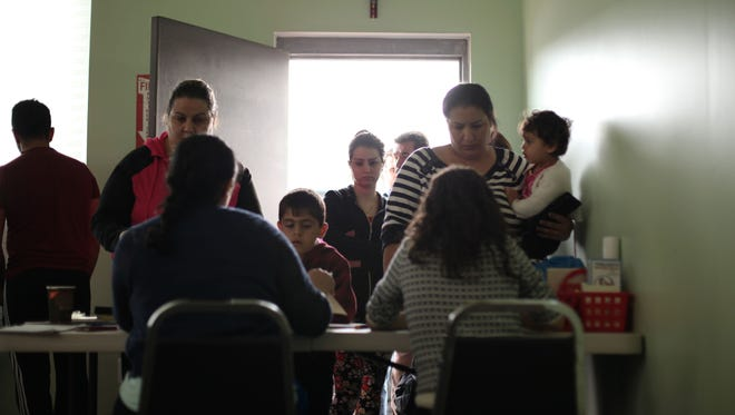 Iraqi refugee families register for assistance at the Chaldean American Ladies of Charity Center on Oct. 10, 2014, in Troy, Michigan. The number of Iraqi refugees admitted into Michigan has dropped sharply. There were only 8 Iraqi refugees sent to Michigan in Fiscal Year 2018, which ended Sept. 30, compared to 2,759 Iraqi refugees sent to Michigan in 2014.