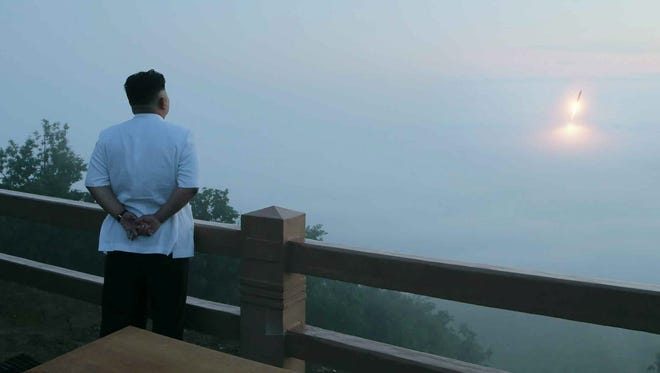 A picture released by the Rodong Sinmun, the newspaper of the ruling North Korean Workers Party shows North Korean leader Kim Jong-un observing a tactical rocket firing drill of the North's Strategic Force at an unidentified place.