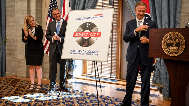 Tennessee Gov. Bill Haslam walks to the podium as Mayor Megan Barry stand with Simon Brooks, SVP North American British Airways, to announce a non-stop flight to London from Nashville at the Tennessee State Capitol in Nashville, Tenn., Tuesday, Aug. 8, 2017.